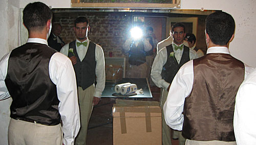 Groomsmen in front of a mirror